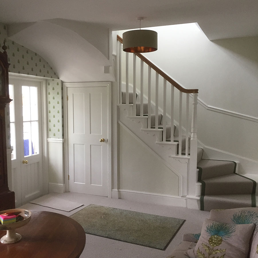 Wooden Staircase above doors